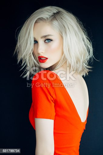 istock Beautiful girl on a bright red background 531799734