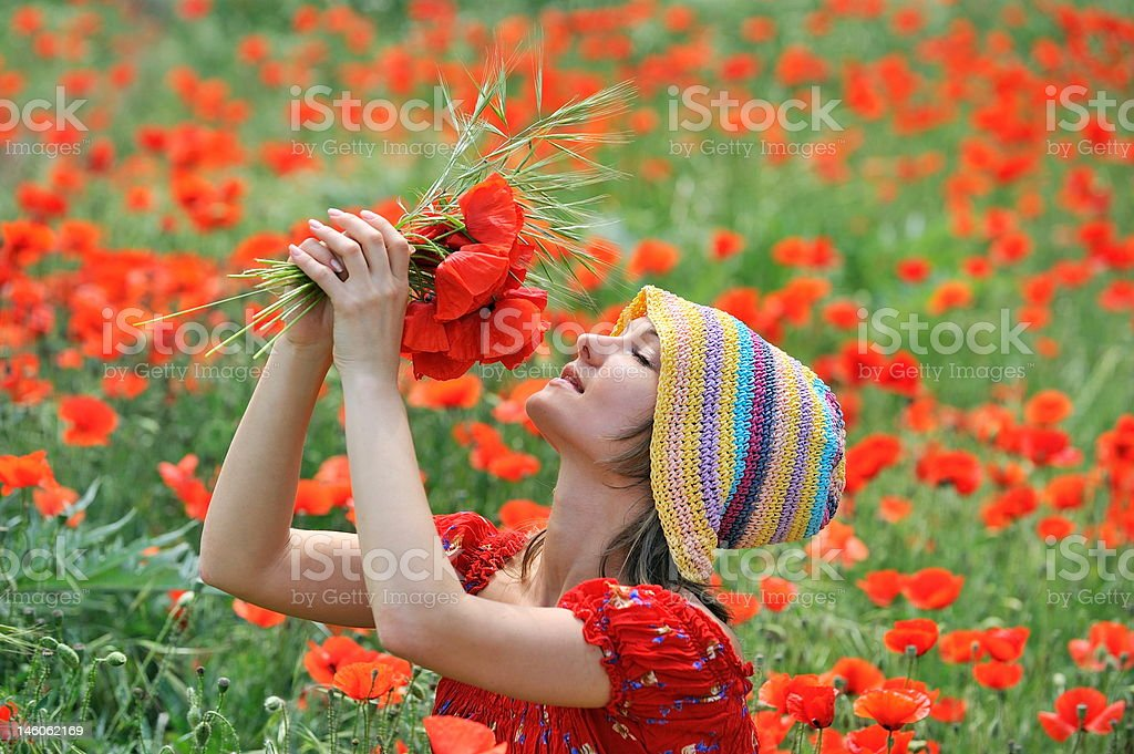 beautiful girl on a field with poppies royalty-free stock photo