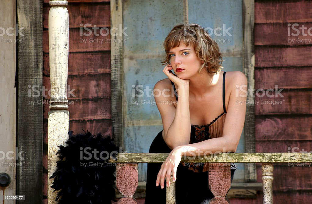 Beautiful Girl on an Old Country Porch stock photo