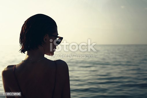 vintage girl between the sea. sun and beach vintage girl