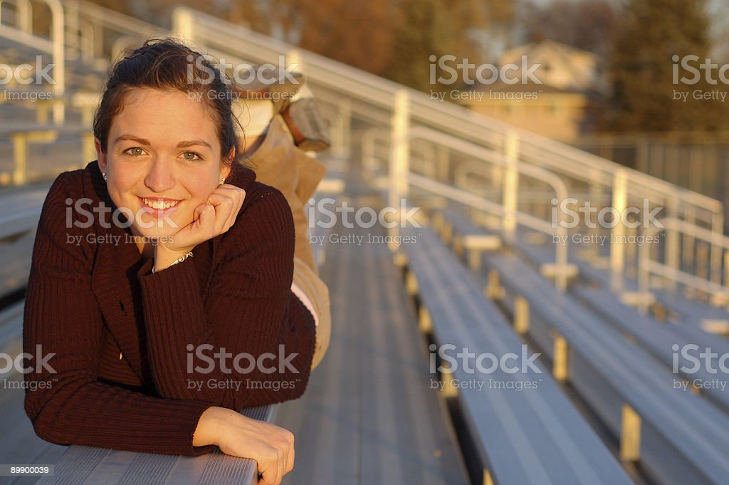 Beautiful Girl on Bench royalty free stockfoto