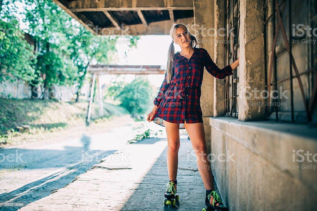 Beautiful girl on roller skates stock photo