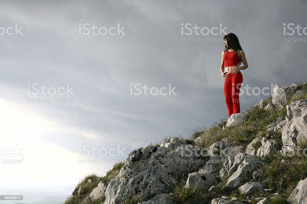 Beautiful girl on top of the mountain royalty-free stock photo