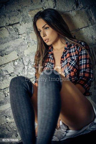 istock Beautiful girl on window 622976646