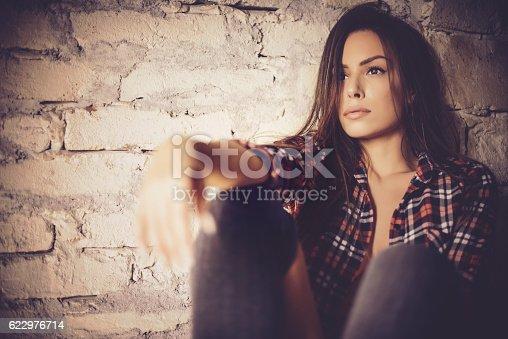 istock Beautiful girl on window 622976714