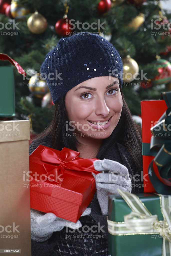 beautiful girl opening Christmas gifts royalty-free stock photo