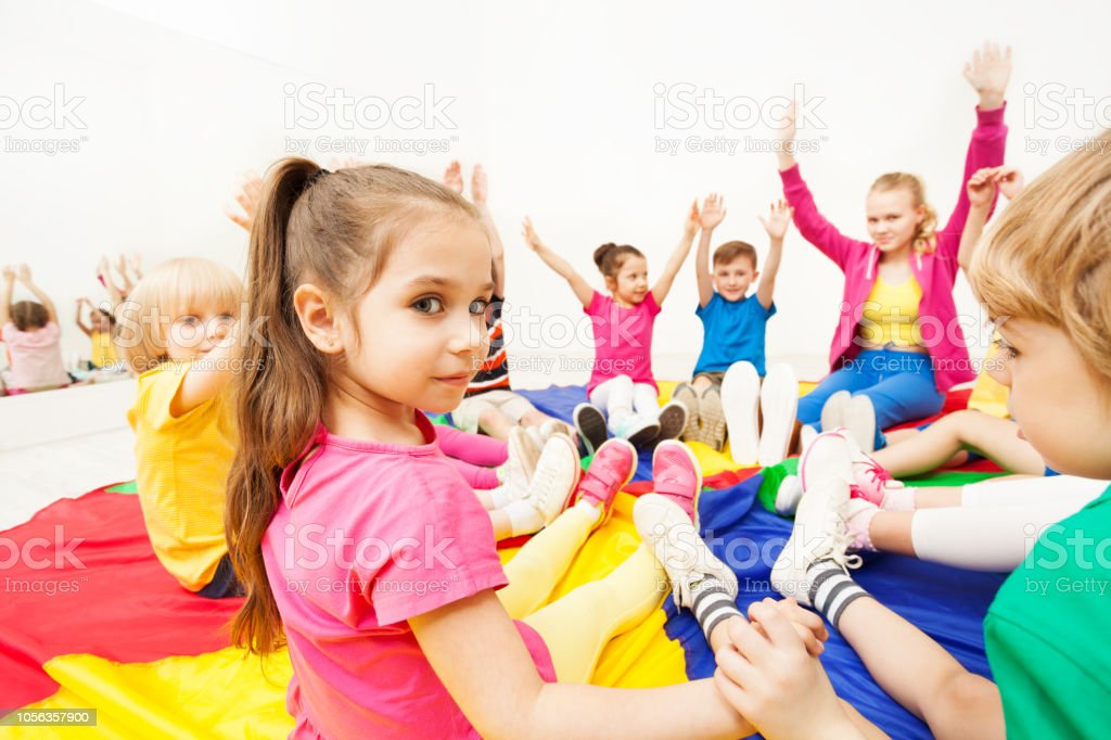 Beautiful Girl Playing Circle Games With Friends Stock Photo - Download  Image Now