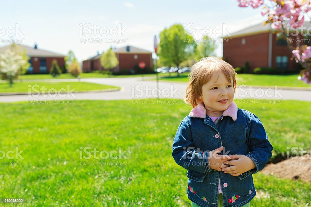 beautiful girl playing in the street in the spring royalty-free stock photo
