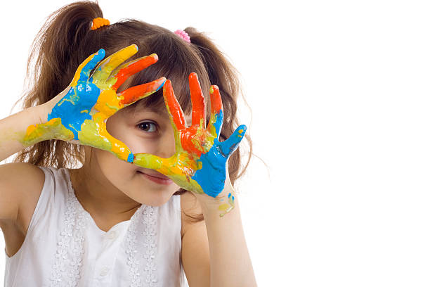 beautiful girl playing with colors - isolated colour stock photos and pictures