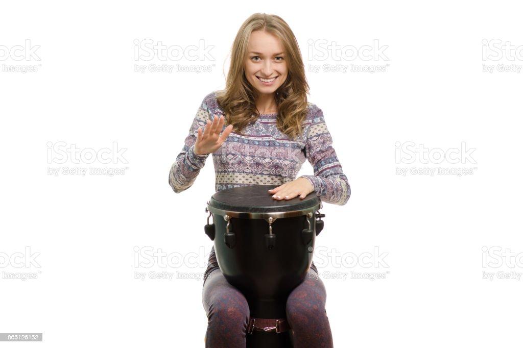 Beautiful girl plays the djembe stock photo