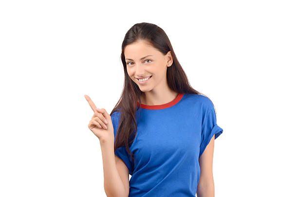 Beautiful girl pointing up. stock photo