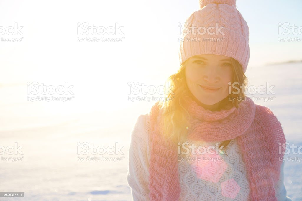 Beautiful girl portrait over winter background. stock photo