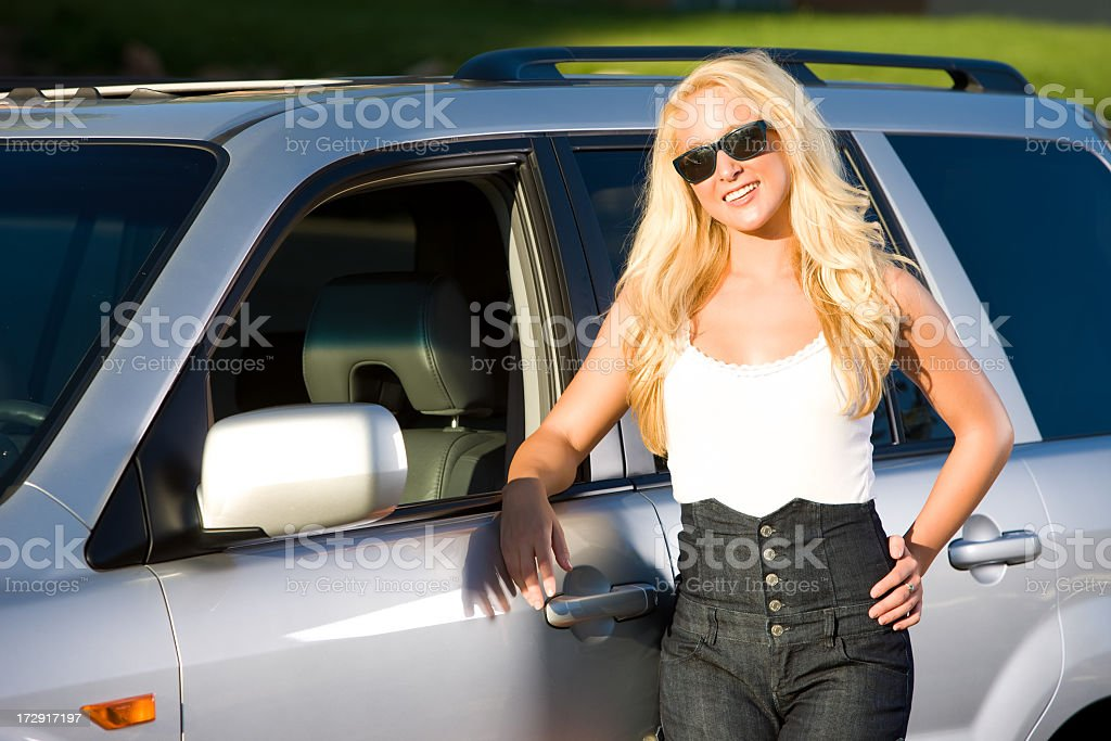 Beautiful Girl Portrait with Her New Vehicle stock photo