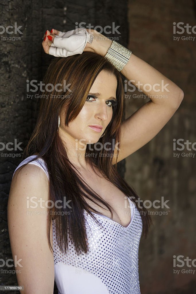 Beautiful girl posing in an abandoned house royalty-free stock photo