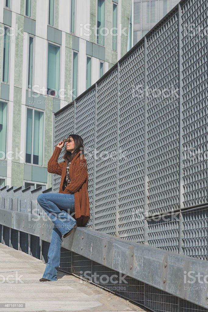 Beautiful girl posing in an urban context stock photo