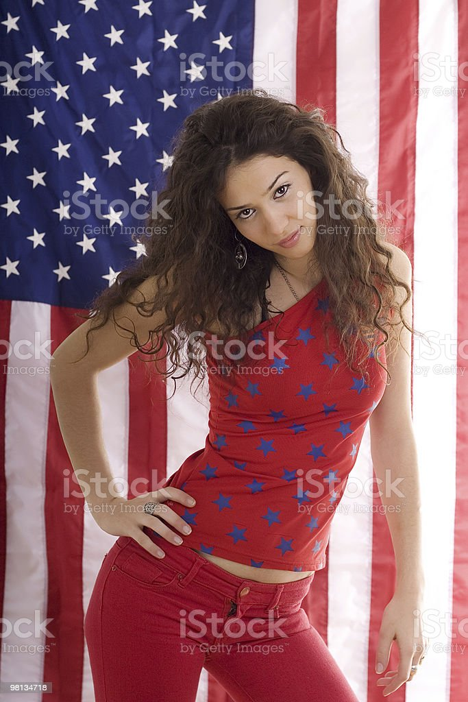 Beautiful girl posing in front of USA flag royalty-free stock photo