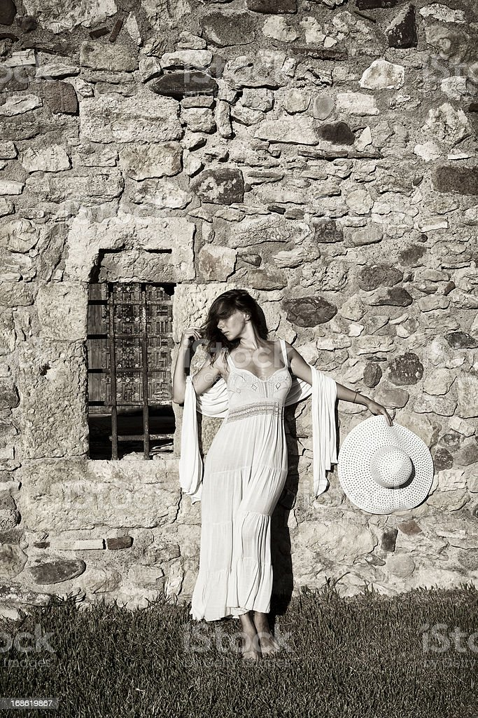 Beautiful girl posing next to an old building in Tarragona stock photo