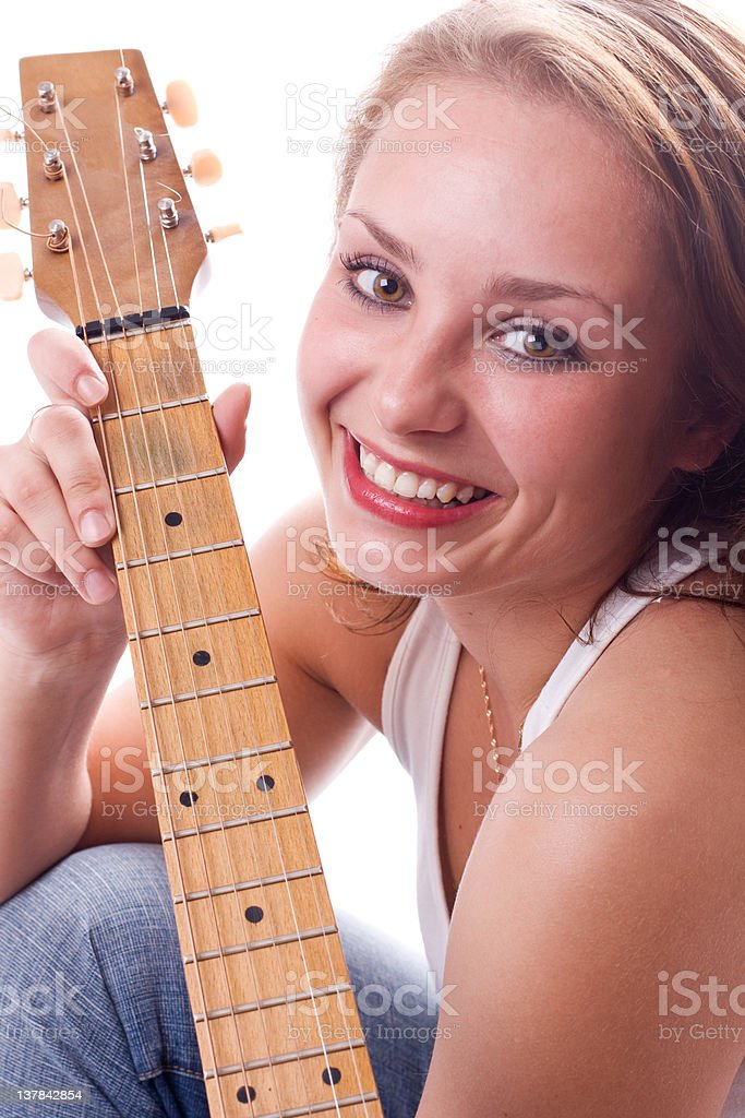 Beautiful girl posing with guitar royalty-free stock photo