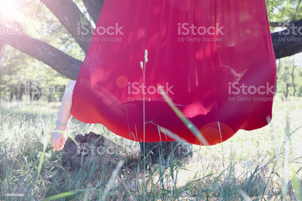 Beautiful girl practicing fly-yoga at the tree .Advanced Yoga Advanced Yoga. Beautiful girl practicing fly-yoga at the tree . Active Lifestyle Stock Photo