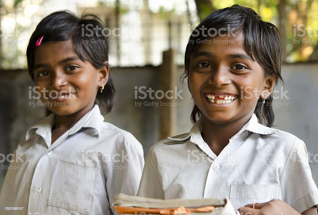 Beautiful girl reading in a school classroom ( India) stock photo
