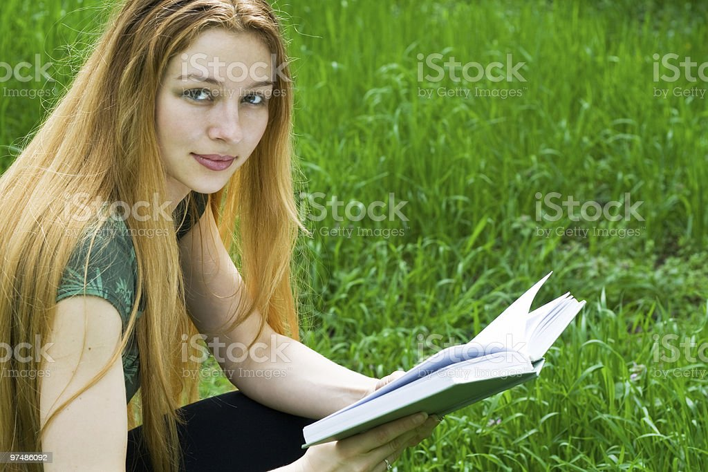 Beautiful girl reading in park royalty-free stock photo