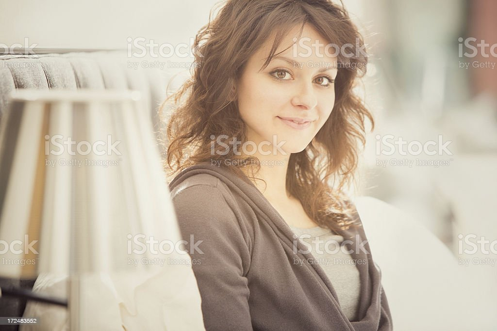 Beautiful girl relaxes in the bedroom portrait royalty-free stock photo