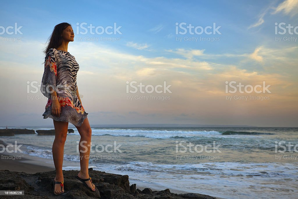 beautiful girl relaxes on background of ocean royalty-free stock photo