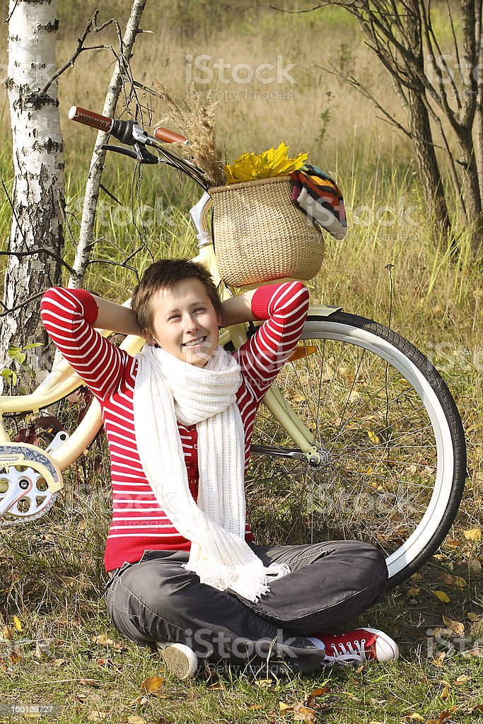 Beautiful girl relaxing near the bike royalty-free stock photo