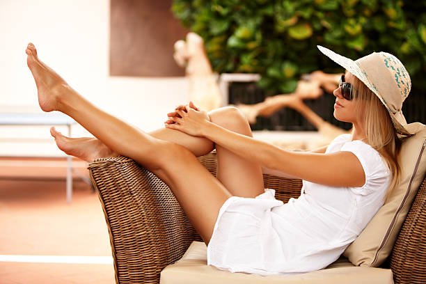 beautiful girl relaxing on a resort - human leg stock photos and pictures