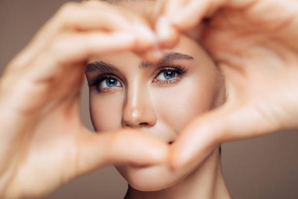 Beautiful Girl Showing Love Sign stock photo