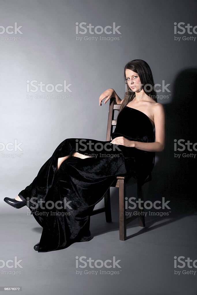 Beautiful girl sit on stool royalty-free stock photo