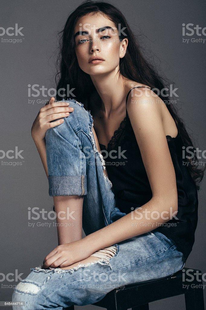 Beautiful girl sitting at the studio stock photo
