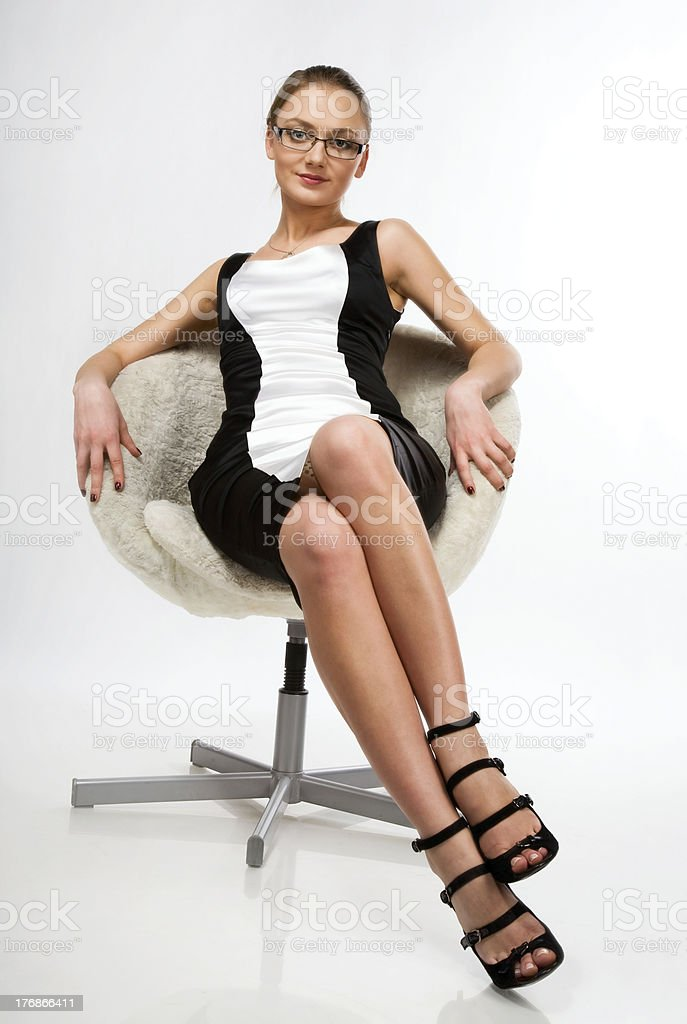 beautiful girl sitting on a chair royalty-free stock photo