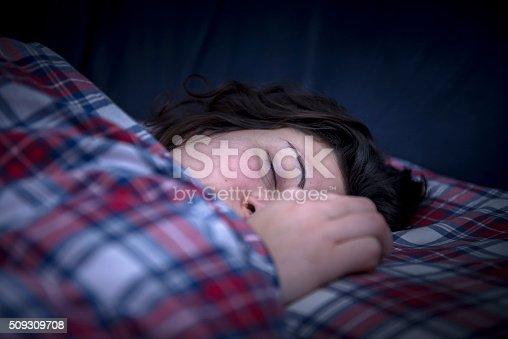 istock Beautiful girl sleeping 509309708
