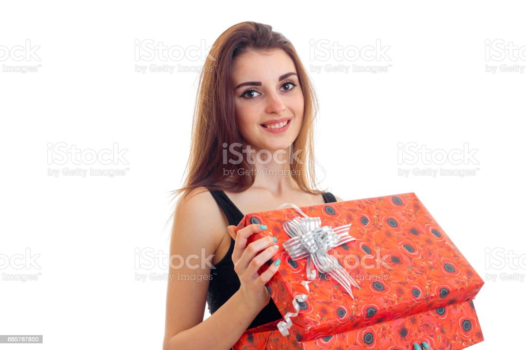 beautiful girl smiling and holding a big red gift box close-up stock photo
