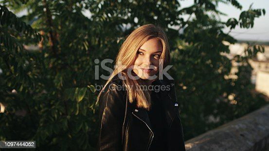 Portrait of young smiling woman. Sunrise