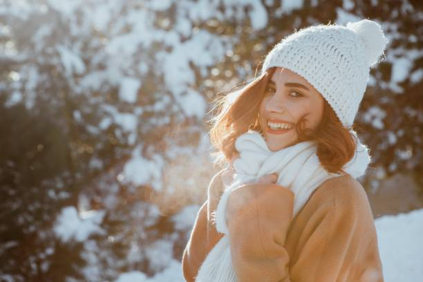 Beautiful Girl Smiling In The Snow stock photo
