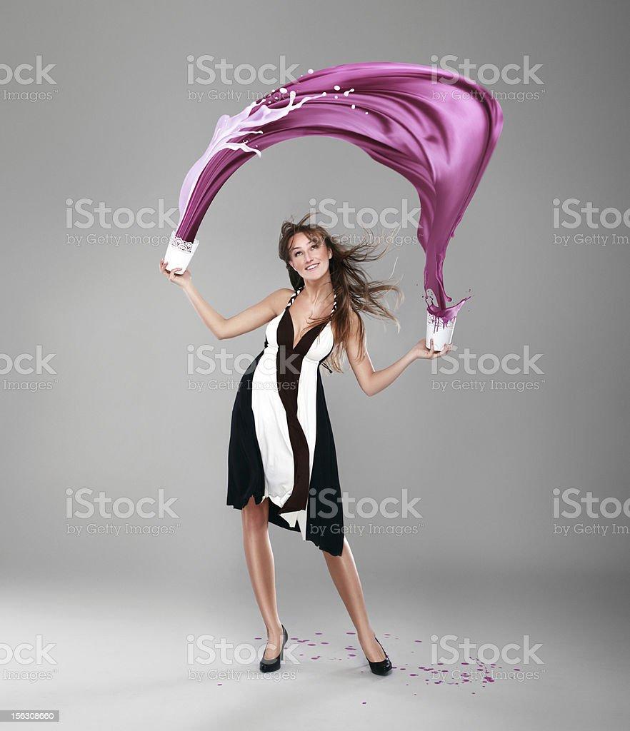 Beautiful girl splashing paint royalty-free stock photo
