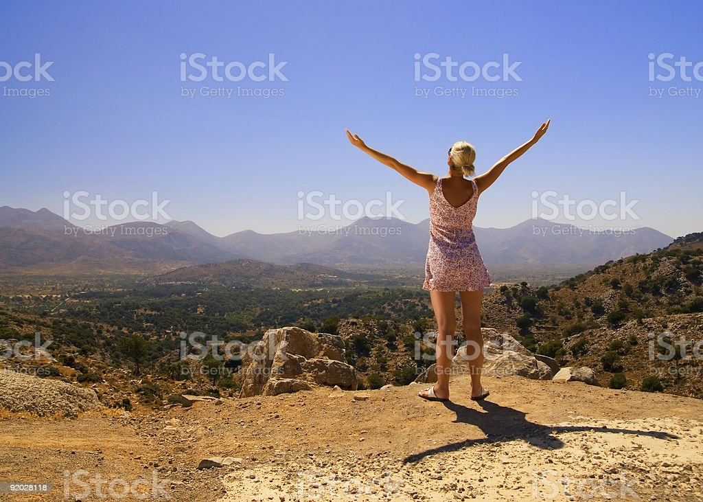 Beautiful girl standing on a mountain royalty-free stock photo