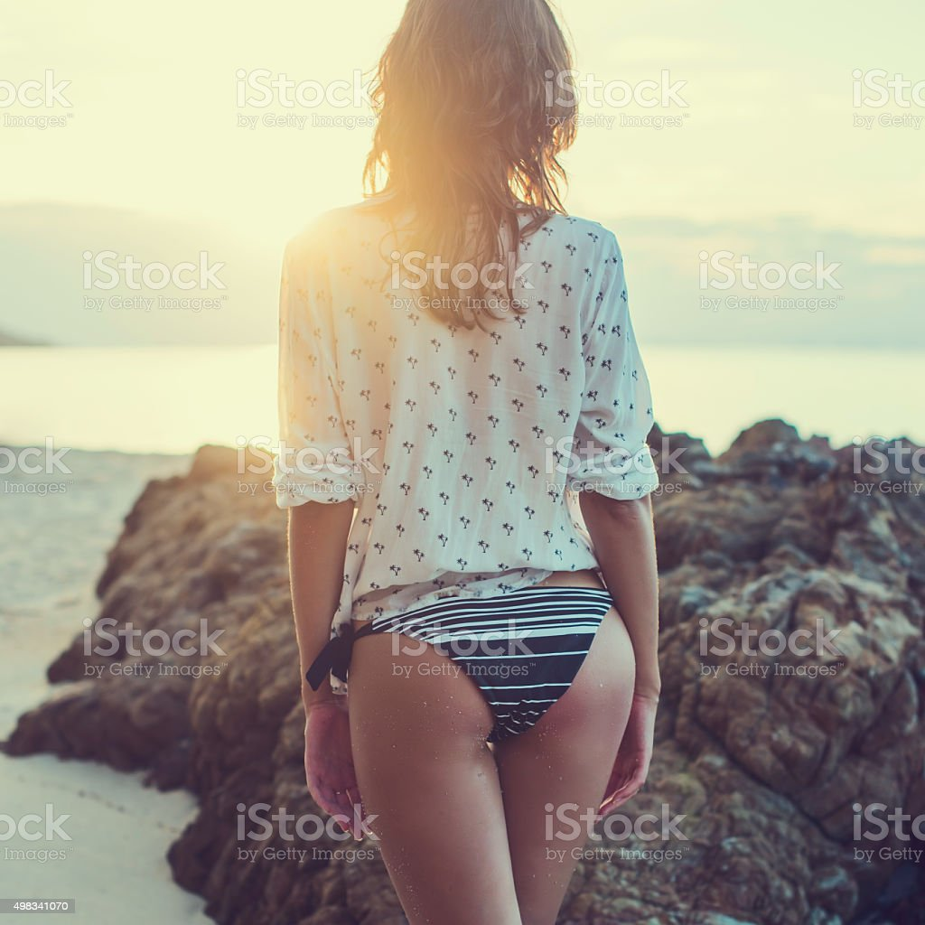 Beautiful girl sunrise at seaside. Beach sunset evening. concept love stock photo
