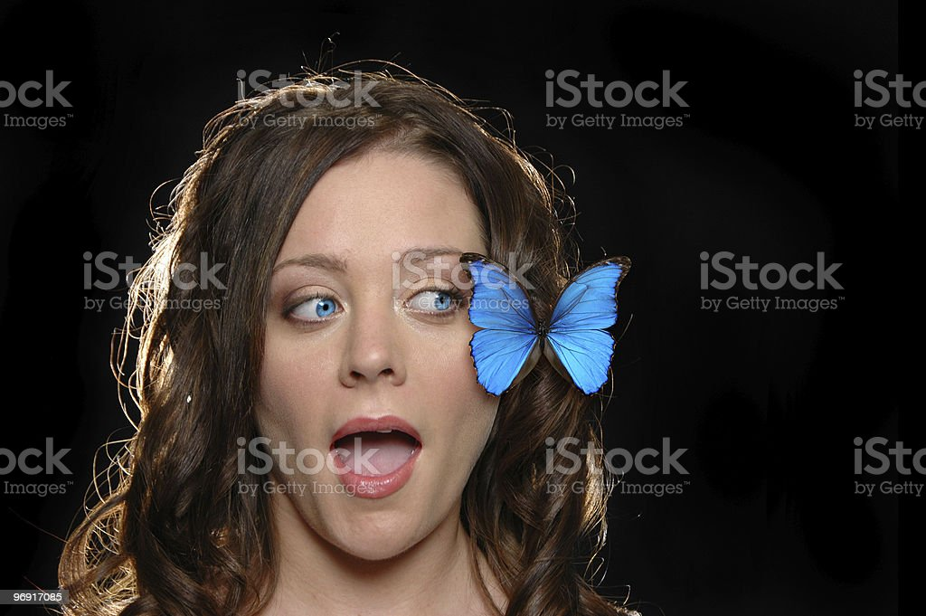 Beautiful girl surrprised with butterfly royalty-free stock photo