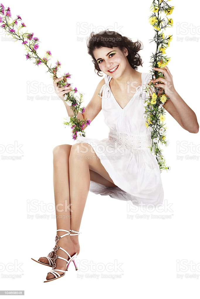 Beautiful girl swinging on flower swing. royalty-free stock photo
