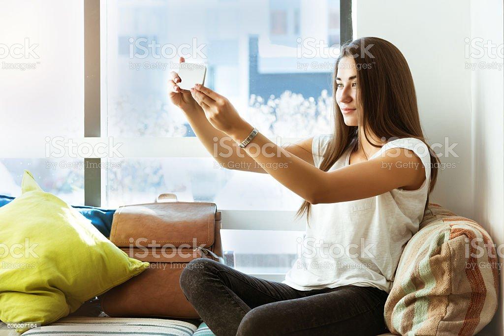 Beautiful girl taking selfie mobile phone cafe Beautiful girl taking selfie on mobile phone in cafe Adult Stock Photo