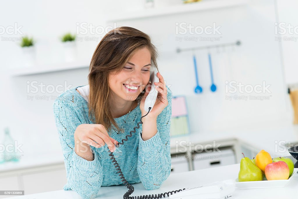 beautiful girl talking on the phone stock photo