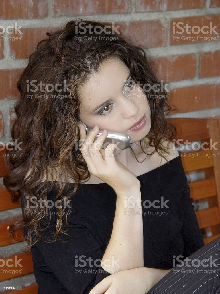 Beautiful girl talking on the phone - Royalty-free Adult Stock Photo