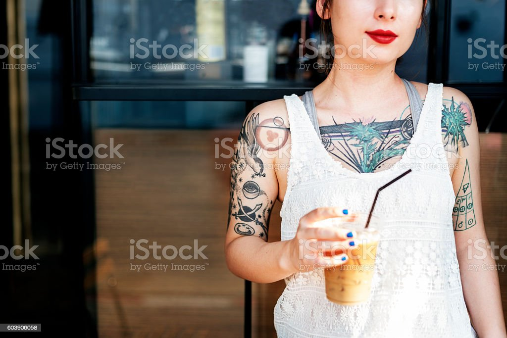 Beautiful Girl Tattoo Young Teenage Calm Casual Concept stock photo