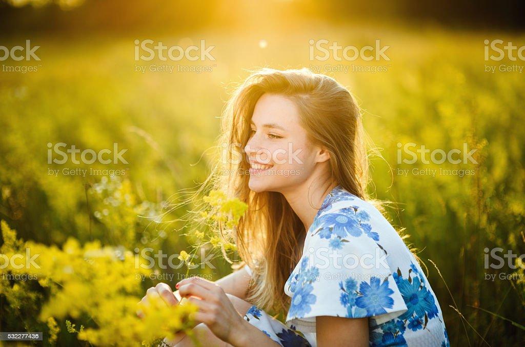Beautiful girl the flowers field woman the flowers field sunset