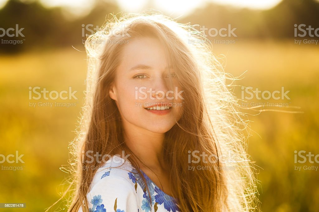 Beautiful girl the flowers field woman the flowers field sunset stock photo