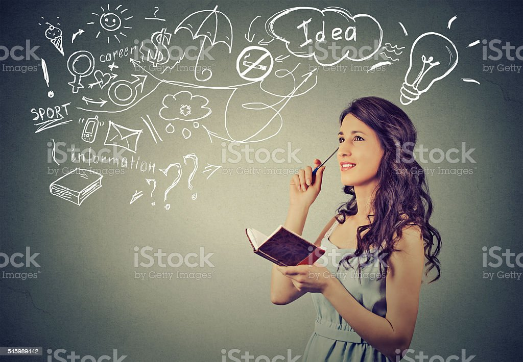 beautiful girl thinking planning stock photo