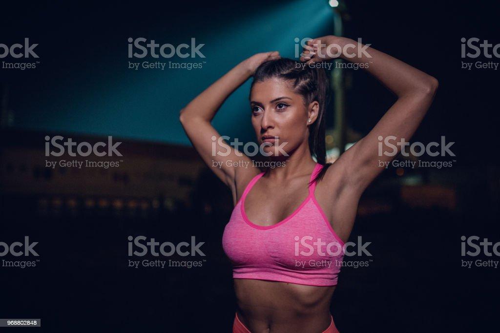 Beautiful girl training at night royalty-free stock photo